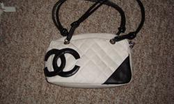 I am selling a black and white CHANEL purse.  Looks brand new.    Asking $30 OBO