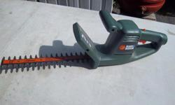 """Black & Decker 13"""" electric hedge trimmer for sale. Good working condition. Only $25. We are located in Orleans. See our list of other items for sale. First come, first served."""