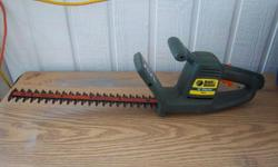 """Black & Decker 16"""" electric hedge trimmer for sale. Good condition. Only $30. We are located in Orleans. See our list of other items for sale. First come, first served."""