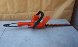 "Black & Decker 16"" electric hedge trimmer for sale. Only $30. We are located in Orleans. See our list of other items for sale. First come, first served."