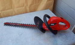 "Black & Decker 20"" electric Hedgehog hedge trimmer for sale. Only $45. We are located in Orleans. See our list of other items for sale. First come, first served."