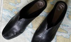 Black leather uppers, formed sole with slight heel. Can be dressy or casual. Size 8M. Worn one afternoon.