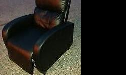 BLACK FAUX LEATHER RECLINER CHAIR.. $250 Great condition... Moving sale Delivery available for $20