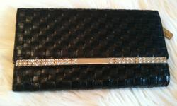 Black and gold clutch/wallet with pink satin interior. Several interior compartments for credit cards and cash. Zipper coin compartment as well.   Asking $10 obo   *Please check out my other ads!