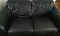 2 Seat black leather couch, like new, no rips, tears or stains. 57 inches L x 38 inches W x 35 inches H Can be sold with 3 seat leather sofa.