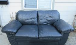 Black Leather Love Seat in Really Good Shape! Hardly any wear or Tear! Just a little bit at the back which can hardly be seen! Also a little bit on the front right hand side at the very bottom as you can see in the pictures! The couch looks great and is