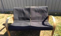 Ikea style black leather love seat, could use a good cleaning.