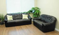 Black leather sofa and love seat for sale. Still very sturdy, firm, and comfortable. No holes, rips, or tears but the leather is quite worn (please see closeup photo). It has a solid wood frame with hand-tied coils so would be an ideal candidate for a