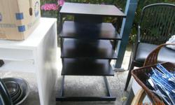Black shelves to hold VCR's, Amps, etc. Measures 24 inches across widest part x 19 inches front to back x 35 inches high