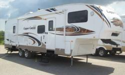 This add is for a 30ft 2009 copper canyon 5th wheel trailer made by keystone it is actually 35 feet long. Used 4 weeks like new condition. There are 2 large slide outs or tipouts with 3 bunks in the rear, this trailer sleeps 10 people. Second door enters