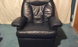 Blue leather recliner. Its a comfortable chair In good overall condition.