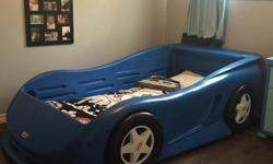 Blue racecar bed for sale in good condition. My son loves it but we are upgrading to a bunk bed. Mattress not included, asking 200.00, Call 705-943-8685