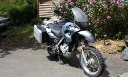 """2001 BMW F650GS, blue/silver, 58,000Km. Very well maintained and ready to ride. Comes with BMW System panniers and rack, 12V power outlet, heat grips, TKC 80 road/off-road tires, fork protectors and lowered seat (5' 2"""" works !). Recent maintenance: new"""