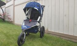 Bob Revolution Jogging stroller. Good condition and very easy to use. Front wheel can be locked in place for jogging, or unlocked for easy turning. Infant car seat adapter included. Folds easily for the car trunk or storage.