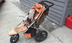 Well loved BOB stroller. Everything works fine, but the canopy is a bit loose after 7 years (but still keeps baby dry if you're walking in the rain). Sun bleached faded orange ... looks great! Thank you for looking