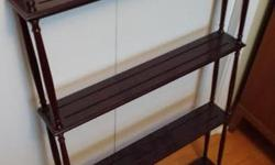 """Bombay Company shelf to display your collectibles, plates, knick-knacks etc. It is in excellent condition. 4 shelves, and each shelf has 2 grooved slots to keep your treasures in place. Dark cherry/mahogany finish. Approx 24"""" wide by 38"""" height. $49 or"""
