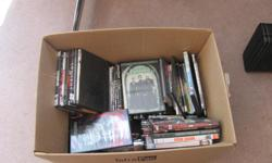 Box of 100 dvd movies Sold in one lot $25