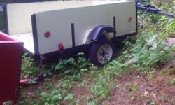 """Box trailer 7' long x 4' wide with removeable tailgate, 12"""" tires, new lights and plywood , freshly painted."""