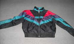 """Boy's """"ATHLETIC WORKS"""" jacket, size L/G (14) black, with green, purple and red detail stripes. 100% nylon shell with cotton/poly white lining. Zipper front and slash pockets on sides, elasticized cuffs and waistband. good condition, no rips or tears."""