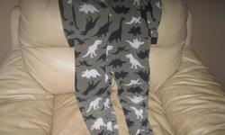 Boys 1piece PJS Size 7 Brand - Carters Dinosaurs In Great condition $15 can meet in west end of ottawa (kanata) or pickup in Constance bay