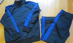Boys size 10 athletic pants and jacket Navy with contrast blue pining/trim. Both in like-new condition.