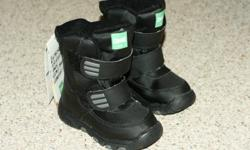 Size boys 10, black, made by Cougar. Regular $60. Warm and waterproof.  Brand new and never been worn.