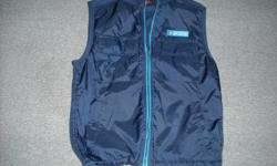 """Brand new boy's size """"M"""" (approx. 12/14 youth) vest, """"SPORTEK"""" 100% polyester with nylon trim, adjustable pull tabs at bottom edge, 2 velcro square pockets upper front and slash side pockets."""