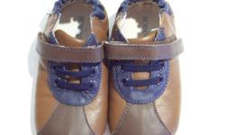 Adorable brown and navy Robeez Mini Shoez ?Lil Sport?.  Brand new in box.  Never worn.  Only opened to take picture.  Size 3-6 months.  Selling for $20.   Velcro closure with elastic at ankle to the shoes on. Laces for looks. Soft leather to protect