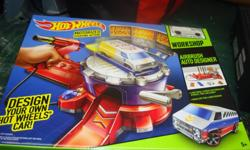 I have a Brand New Hot Wheels Motorized Airbrush Designer Toy for sale! This is in excellent condition and would look great in your child's room or to give as a gift. Retails for $50 in stores so this is a great deal. Hot Wheels Airbrush Auto Designer: ·
