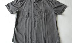 This Marks & Spencer Autograph short sleeve shirt is brand new without the tags and has never been washed and/or worn. It is a men's size XL slim fit. The shirt is made from a very nice thin striped black and grey fabric. Please have a look at the list of