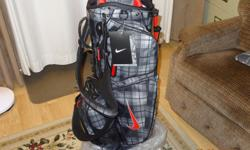 The bag has all the tags still on it and the plastic wrappings. Has 8 dividers for your clubs.and 9 pockets for all your equipment. Really has all the fancy stuff. A real quality bag.