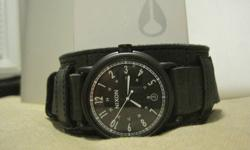 Brand new never used Nixon Axe watch. Made with Horween Leather. Original price $350