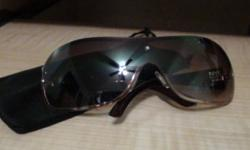 brand new, not used sunglasses..sticker still on.. two sunglasses, same style, brown/gold and silver. text me 5194024587. thanks