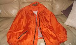 BRAND NEW PENMANS Nylon Jacket Never Worn Size Medium Color - Orange Can meet in west end of Ottawa (Kanata) or pickup in Constance Bay