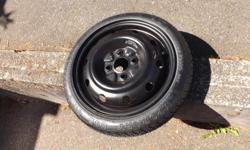 """This is a brand new, never mounted or used in any way spare Tire. Says: """"Goodyear Convenience Spare"""" """"Temporary Use Only"""" Size T115/70D14 88m"""" Will fit most Mid-sized/Smaller cars. Like New! $30.00 Firm"""