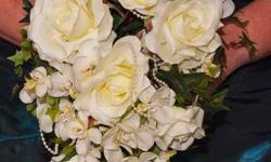 Gorgeous white & cream artificial flowers, with cascading lace trim. Condition:  as new (used for very short wedding!).  Asking $40 OBO.