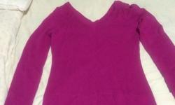 I have a bright pink sweater available with a v-neck and v-back. Worn once. Size medium. Asking $5.