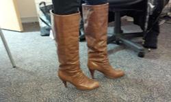 This is a beautiful pair of brown leather boots size 9. In excellent condition