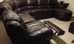 Large Sectional Sofa, u-shaped, with one end recliner and the other end chaise lounge. Dark brown leather, good condition. Three pieces. Chaise lounge 3 ft. wide, next couch section 8 ft.long, recliner piece 7.5 ft. long. Call Denis on cell 613 223-1988