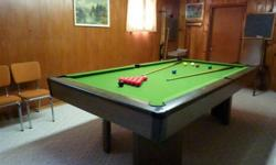 """This table has a 44"""" x 88"""" slate playing surface and is in very good condition. Cues and 2 sets of balls are included.   For further information, please phone 306 545 2162."""