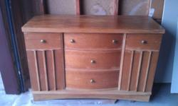 for sale buffet, cupboards on each end and 3 drawers that open in the middle