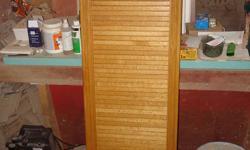 Built in ironing board With garage door honey oak in color