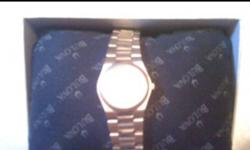 Brand new, worn once Silver/gold detail Still in box & have warranty papers Water Resistant Day of the month indicator on face of watch New batteries   Selling as I do not wear it. Asking $150 OBO Just in time for Christmas for that special lady!