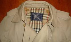 This is a beautiful beige Burberry trench coat in excellent condition. New it retails for over $895. Size Small +. (Shoulders at 18' and 42' long) A gift from England but a bit too big for me. Bought at Harrods. No stains.  In perfect condition.