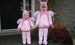 Pink, two piece butterfly costumes with hoods, bows and sparkle fabric on the wings is sure to please your little girls!  These are warm and cozy for a cool evening of trick-or-treating.  $20 each.  Pick-up only - Halloween will soon be here, so no holds