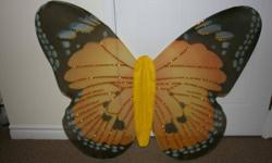 """Butterfly Wings   Measurements: Length (wingspan) - 37.5"""" Height - 30""""   Each pair is made with a mess-nylon material with two white, stretchable shoulder straps. They are beautifully made and make a great costume for children, teens, and adults.   The"""