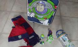 BuzzLightyear Travel luggage, hat set and Plastic Toys. All are in excellent condition. Like new. Everything in the pictures is for this price.