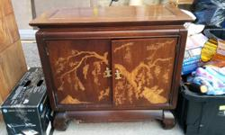Beautiful cabinet with asian inspired decoration. Cabinet has visible wear on the top but still very functional. From storage. Dimensions 2.4ft H, 2.7ft W, 1.4 ft D $40 or best offer