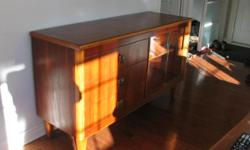 I have a beautiful solid wood cabinet that has 3 large drawers and two sliding glass doors on the side. It measures 20 inches deep, 60 inches wide and is 34 1/2 inches in height. smoke free in Rockland
