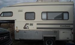 I have an  slide in camper that has been made into a 5th wheel. The hook up for the 5th wheel is included. There is lots of storage even a closet. It has a 2 way fridge with a freezer on top. There is a 4burner stove,oven and a range hood. It has double